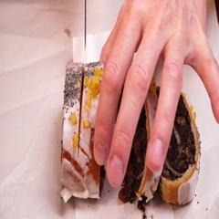Female hand slicing poppy seed cake closeup 4K Stock Footage