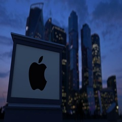 Street signage board with Apple Inc. logo in the evening. Blurred business Stock Footage