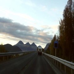 Driving on road E8 and following a RV, towards the city of Tromso, on a late  Stock Footage