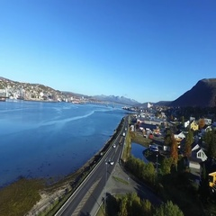 Aerial rising view of the road in front of the city of Tomso, in north Norway Stock Footage