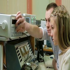 Young woman engineer student working with a man in the laboratory with an Stock Footage