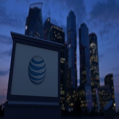 Street signage board with American Telephone and Telegraph Company AT&T logo Stock Footage