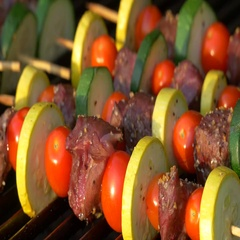 Person Rotating Kabobs on Grill, 4K Stock Footage