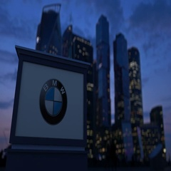 Street signage board with BMW logo in the evening. Blurred business district Stock Footage