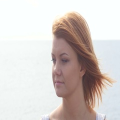 Close up portrait of beautiful young redhead woman on the beach Stock Footage