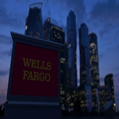 Street signage board with Wells Fargo logo in the evening. Blurred business Stock Footage