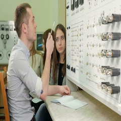 A group of students working together on a test bench Physical Laboratory. Many Stock Footage