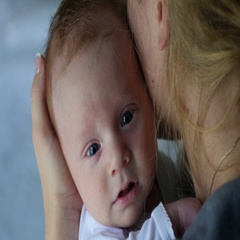 Mother holding and calming down her baby Stock Footage