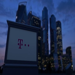 Street signage board with T-Mobile logo in the evening. Blurred business Stock Footage