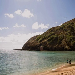 Tides: Hawaii, Bay with Clouds and Swimmers during Day Stock Footage