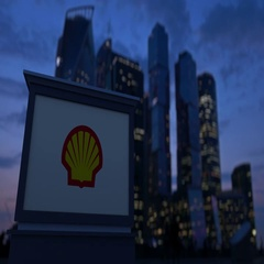 Street signage board with Shell Oil Company logo in the evening. Blurred Stock Footage