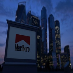 Street signage board with Marlboro logo in the evening. Blurred business Stock Footage