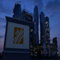 Street signage board with The Home Depot logo in the evening. Blurred business Stock Footage