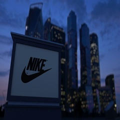 Street signage board with Nike inscription and logo in the evening. Blurred Stock Footage