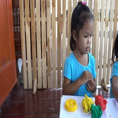 Fun little girl with play dough modelling clay for kids Stock Footage