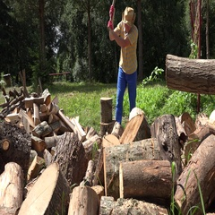 Man chop wood with axe yard. Firewood preparation for winter. 4K Stock Footage