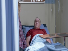 Doctor greets mature hospital patient as he talks with visiting daughter 4K Stock Footage