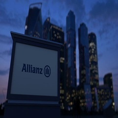 Street signage board with Allianz logo in the evening. Blurred business district Stock Footage