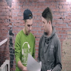 Young man explain something to another. Actor casting. Brick wall background Stock Footage