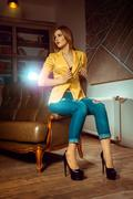 Vertical photo of sexy woman in yellow unbuttoned jacket Stock Photos