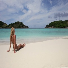Young woman sunbathing on a beach, Sandy spit, british virgin islands Stock Footage