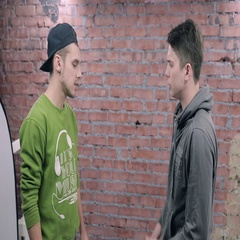 Young man say some sad news to another man. Actor casting. Brick wall background Stock Footage