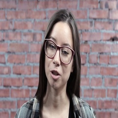 Young girl with glasses positively speak in camera, smile. Casting. Actress Stock Footage
