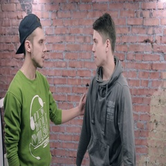 Young man say something sad to another man. Actor casting. Brick wall background Stock Footage