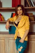 Cute young girl in a yellow jacket unbuttoned Stock Photos