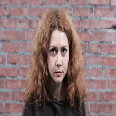 Woman with reddish curly hair depict fear, alertness in camera. Casting. Actress Stock Footage