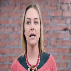 Blonde girl depict emotionless face look in camera. Casting. Actress. Brick wall Stock Footage