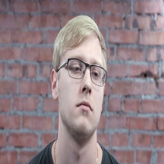 Portrait young blonde man in glasses rocking, concentrate on thoughts on camera Stock Footage