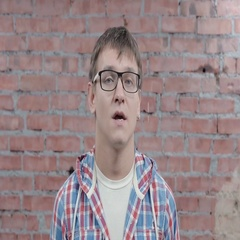Portrait of young man in glasses emotionless speak in camera. Casting Stock Footage