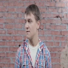 Young man try to make serious face, but smile in camera. Casting. Actor Stock Footage
