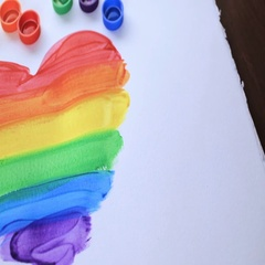 Painting Rainbow Gay Pride heart on a white paper. Stock Footage