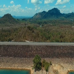 Aerial: Mountain, road and lake with a bird's eye view. Stock Footage