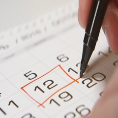 Signing a day on a calendar by red pen (square) Stock Footage