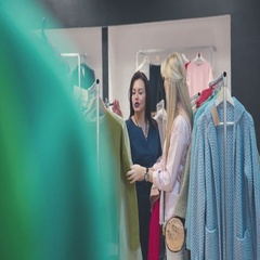 Blonde and brunette discussing clothes in the store. Shopping woman Stock Footage