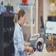 The customer pays for the purchase in the store. Friendly staff Stock Footage