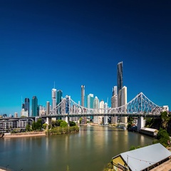 Day time panorama of Brisbane city with Story Bridge and ferries Stock Footage