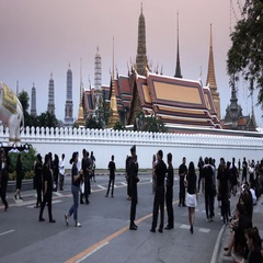 Bangkok Grand Palace time lapse of mourners at dusk Stock Footage