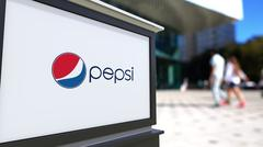 Street signage board with Pepsi logo. Blurred office center and walking people Stock Illustration