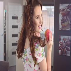 Brunette beauty eating an apple, slow motion Stock Footage