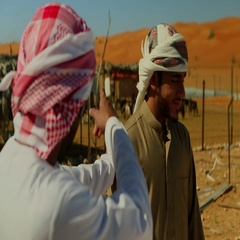 Emirati friends talking on desert. Stock Footage