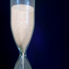 Sandglass on a Black Background, the sand Falls Inside Stock Footage