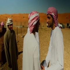 Emirati men greeting each other on desert. Stock Footage
