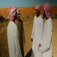 Emirati men talking on desert. Stock Footage