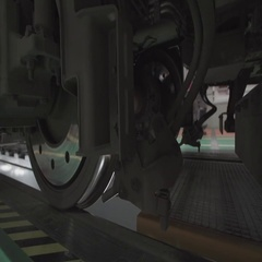 Wheels on chassis of train wagons at workshop in factory Stock Footage
