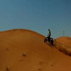 Silhouette of man drifting quad bike on desert. Stock Footage