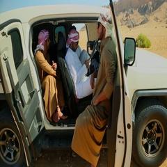 Arab men relaxing in FJ cruiser on desert. Stock Footage